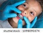 dentist  orthodontist examining ...   Shutterstock . vector #1098090374