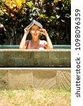 beautiful woman in sexy bikini...   Shutterstock . vector #1098096359