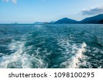 wave trace with white foam on... | Shutterstock . vector #1098100295