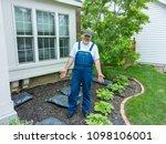 man standing in a flowerbed... | Shutterstock . vector #1098106001