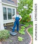 man standing with hands on hips ... | Shutterstock . vector #1098106025