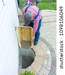 man replacing the old pebbles... | Shutterstock . vector #1098106049