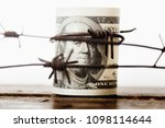 us dollar money wrapped in...
