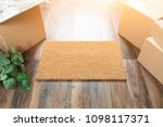 blank welcome mat  moving boxes ...   Shutterstock . vector #1098117371