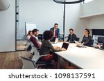 group of coworkers having a... | Shutterstock . vector #1098137591