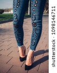 Small photo of woman black high-heels. Close up photo of woman's legs in high heels