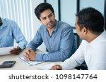 young caucasian leader talking... | Shutterstock . vector #1098147764