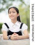 cheerful asian teenager sitting ... | Shutterstock . vector #1098154961
