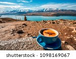 enjoy a cup of coffee in mt... | Shutterstock . vector #1098169067