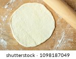 rolling out the dough with a... | Shutterstock . vector #1098187049