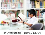 asian student is searching for... | Shutterstock . vector #1098213707