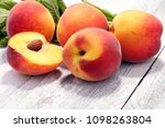 a group of ripe peaches on... | Shutterstock . vector #1098263804