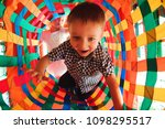 boy playing on the playground ... | Shutterstock . vector #1098295517