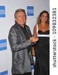 Small photo of LOS ANGELES, CA - SEPTEMBER 24, 2009: Former Monkee, Davy Jones & new wife Jessica Pacheco at the Macy's Passport 2009 Fashion Show at Barker Hanger, Santa Monica Airport.