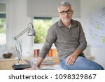 architect in office sitting on... | Shutterstock . vector #1098329867