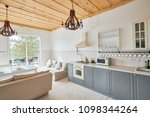 Stock photo wide angle shot of modern kitchen interior with grey counters and white furniture set in 1098344264