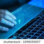 woman scrolling on a laptop | Shutterstock . vector #1098350057