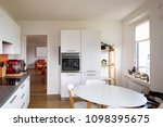 kitchen with orange tiles and a ...   Shutterstock . vector #1098395675