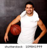 Male basketball player looking happy holding the ball - stock photo