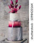 White Wedding Cake With Flower...