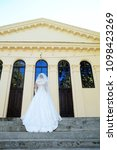 the bride in the wedding dress... | Shutterstock . vector #1098423269
