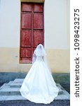 the bride in the wedding dress... | Shutterstock . vector #1098423275