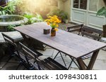 dining wooden table in the...   Shutterstock . vector #1098430811