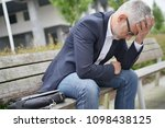 businessman sitting on public... | Shutterstock . vector #1098438125