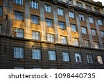 sun shining on old building. | Shutterstock . vector #1098440735