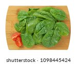 fresh spinach leaves on wooden... | Shutterstock . vector #1098445424