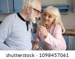 sweet old lady giving her... | Shutterstock . vector #1098457061