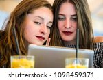 two young and trendy hipster...   Shutterstock . vector #1098459371