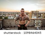 young handsome tattooed man...   Shutterstock . vector #1098464045