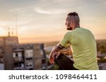 young handsome tattooed man...   Shutterstock . vector #1098464411
