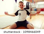 a cute boy in football suit and ... | Shutterstock . vector #1098466049