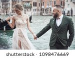 happy wedding couple near the... | Shutterstock . vector #1098476669
