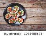 vegetarian bruschetta with... | Shutterstock . vector #1098485675