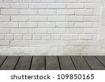 White brick wall with wooden floor - stock photo