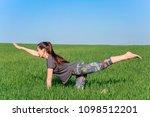 young girl doing yoga outdoor   Shutterstock . vector #1098512201