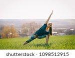 young girl doing yoga outdoor   Shutterstock . vector #1098512915