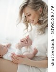 young mother holding her... | Shutterstock . vector #1098528779