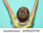 child with arms raised on blue... | Shutterstock . vector #1098529745