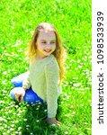 girl sits on grass at grassplot ...   Shutterstock . vector #1098533939