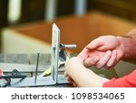 father and son repairing... | Shutterstock . vector #1098534065