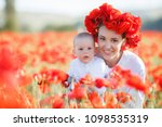 mother with baby playing in a...   Shutterstock . vector #1098535319