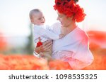 mother with baby playing in a...   Shutterstock . vector #1098535325