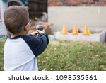 small boy does target practice... | Shutterstock . vector #1098535361