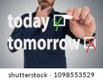 Small photo of businessman with pen choosing between today and tomorrow anti procrastination concept