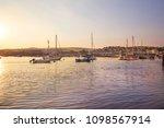 calm sunset over the docks.... | Shutterstock . vector #1098567914