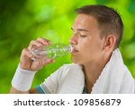 boy drinking water from bottle | Shutterstock . vector #109856879